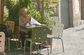 A lady with her morning coffee in Rome